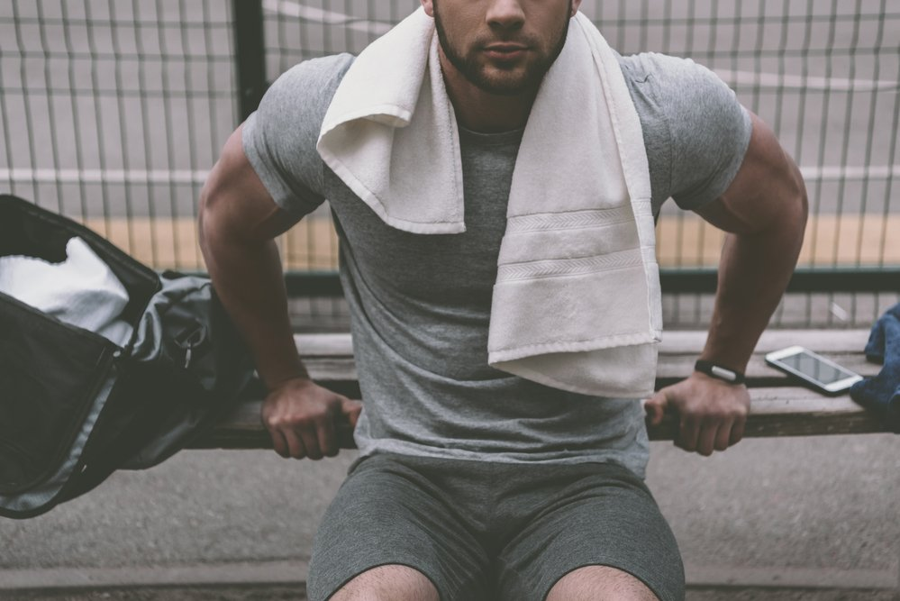 A fit man doing a push up from a bench. Preparation is the key for successful exercise and sport.