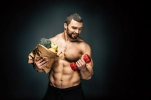 Athletic man holding healthy food