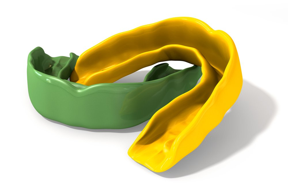 Green and gold mouthguard