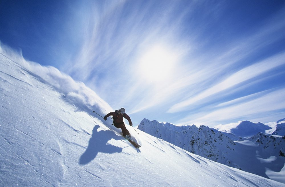Person skiing on a snowy mountain