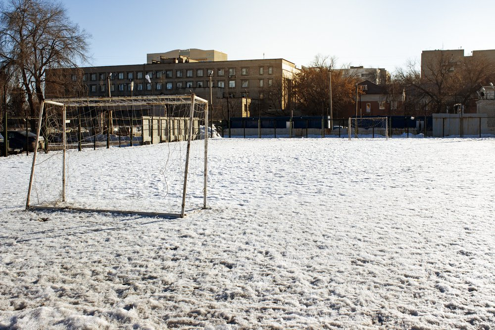 Soccer pitch covered in snow