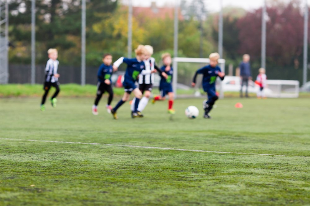 Young soccer players on a flat pitch