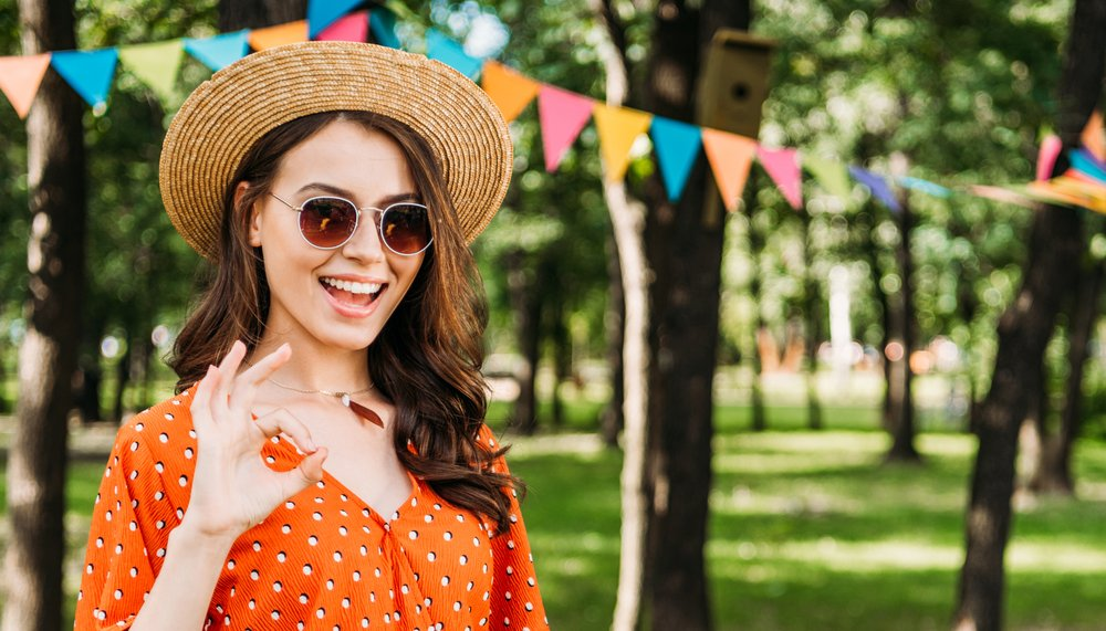 A young woman wearing sunglasses. It is important to keep your eyes safe in the sun