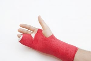 A bandaged arm and wrist with finger injuries
