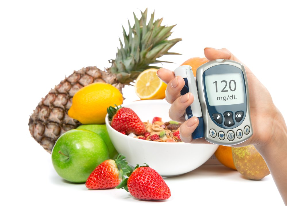 Diabetes glucose monitor in front of fruit