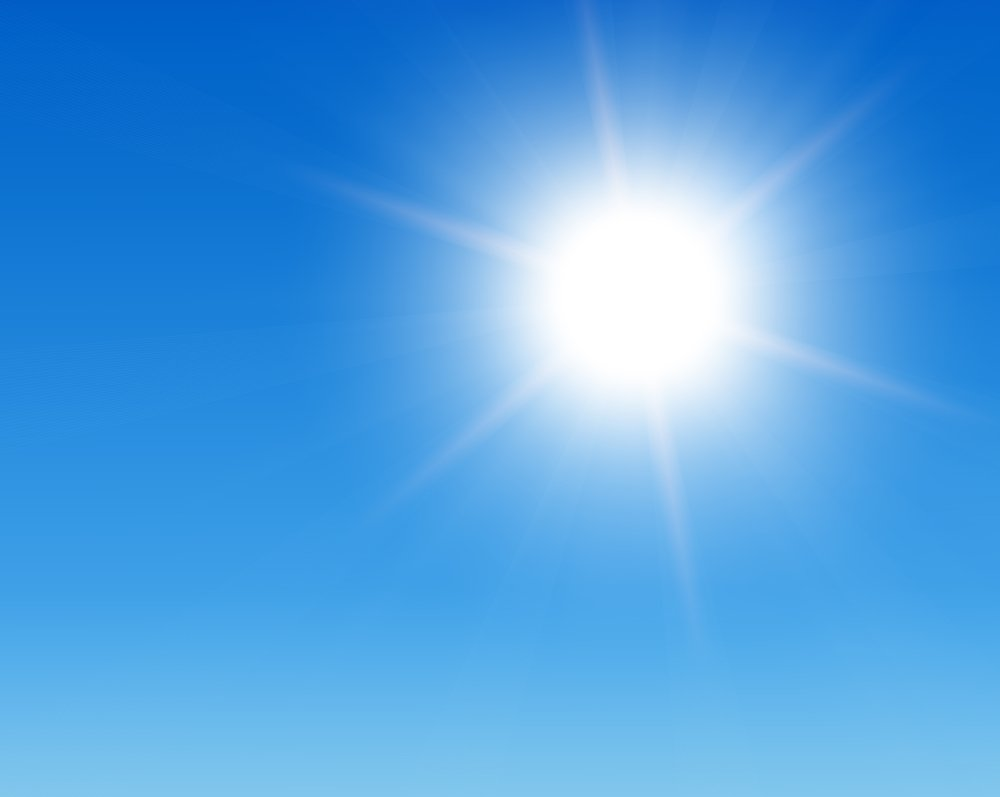 sun beating down in cloudless blue sky