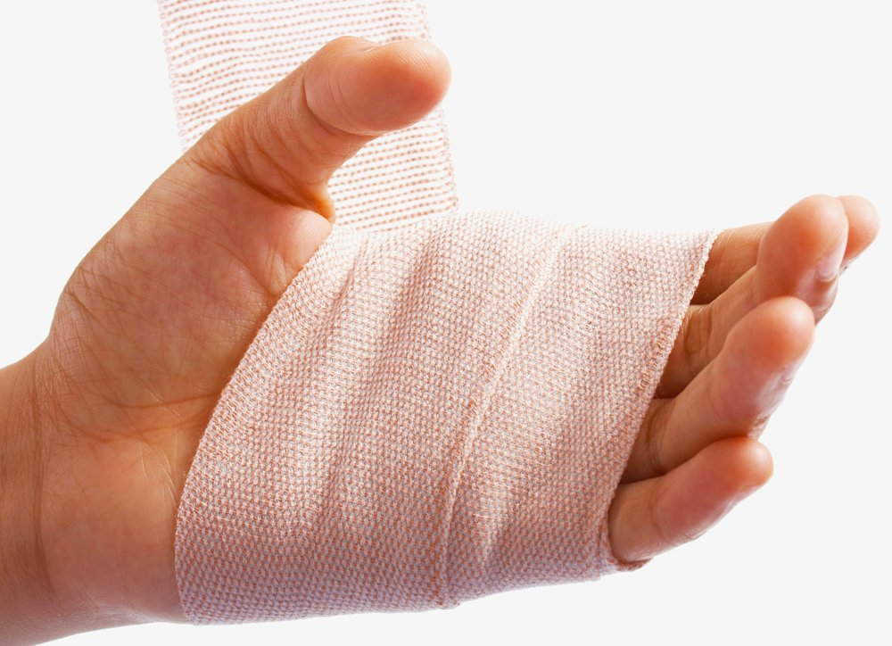 Hand being bandaged because of injury