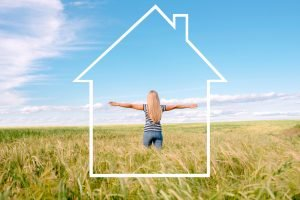 woman in a field imagining a healthy house