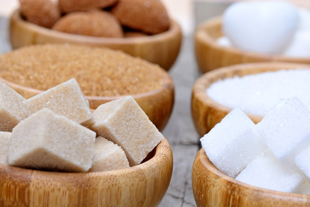 Bowls containing different types of sugar. Not advised as part of a holistic menopause plan