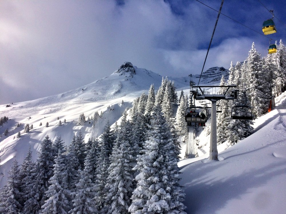 Perfect skiing scene. A snow-covered ski resort with cable car, ready for skiing.
