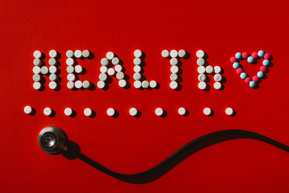 A logo for heart health on a red background. Heart health can be adversely affected by poor adrenal glands function.