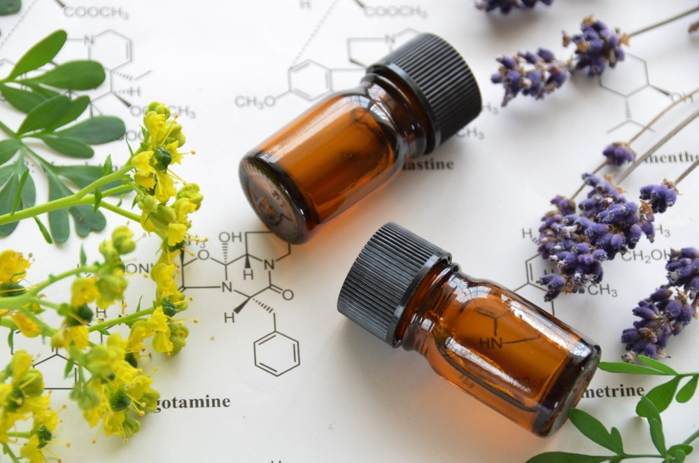 Plants and two essential oil bottles
