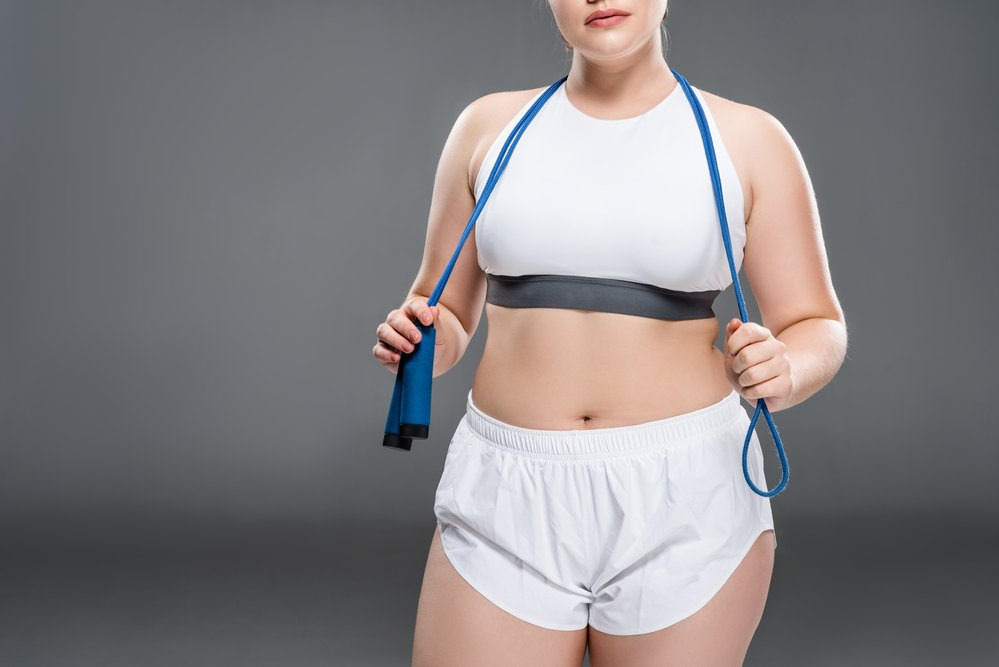 woman with resistance band ready for exercise