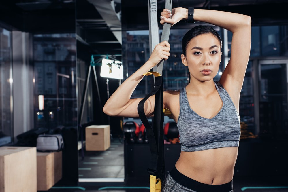A young woman using resistance training