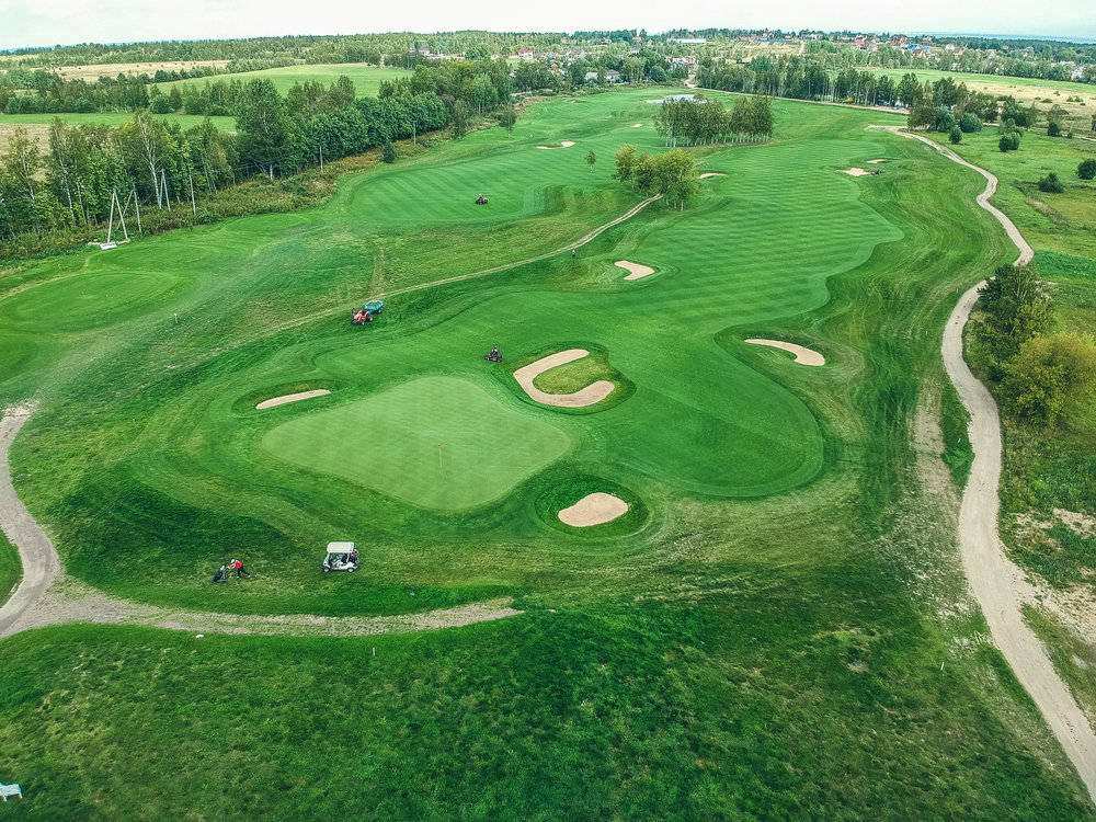 Aerial view of a golf club with golfers playing golf