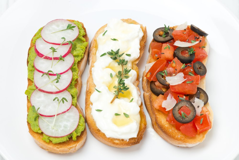 ciabatta with tomatoes, goat cheese, pate with green peas and radish, top view. Nutritionally balanced to help you lose weight as part of a controlled diet