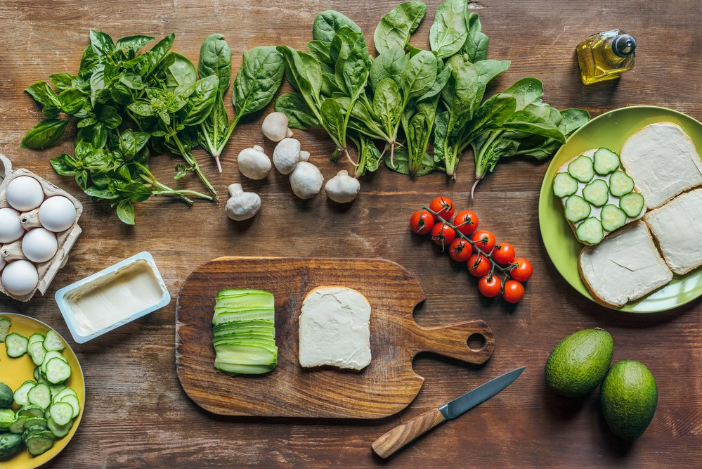 A slection of healthy greens and other foods. You can measure calories for weight loss.