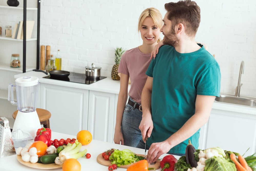A young couple prepping a meal together. Healthy food for burning calories.