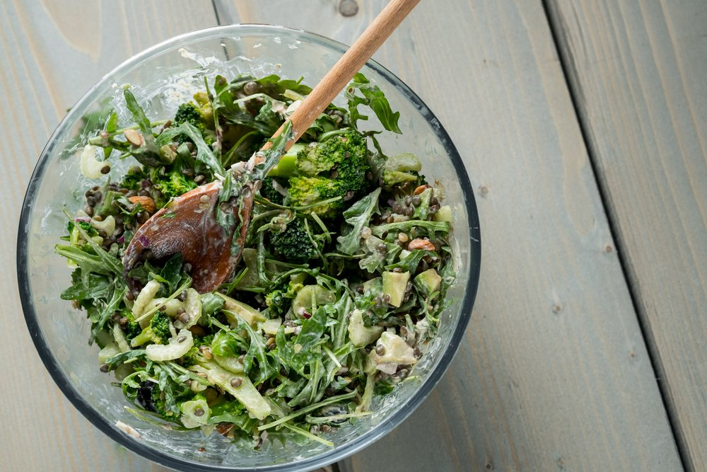 A healthy green salad with spinach and lots of other nutrient-dense veg