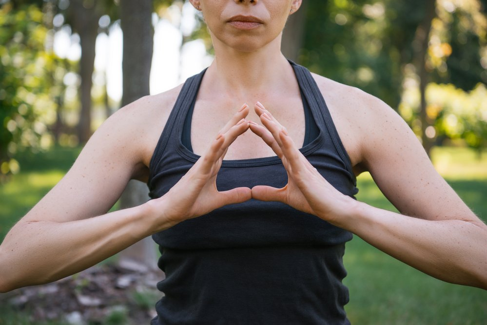 A young woman practising yoga and the power of breath