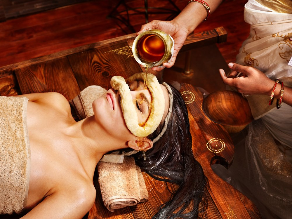 A woman having an Ayurveda treatment.