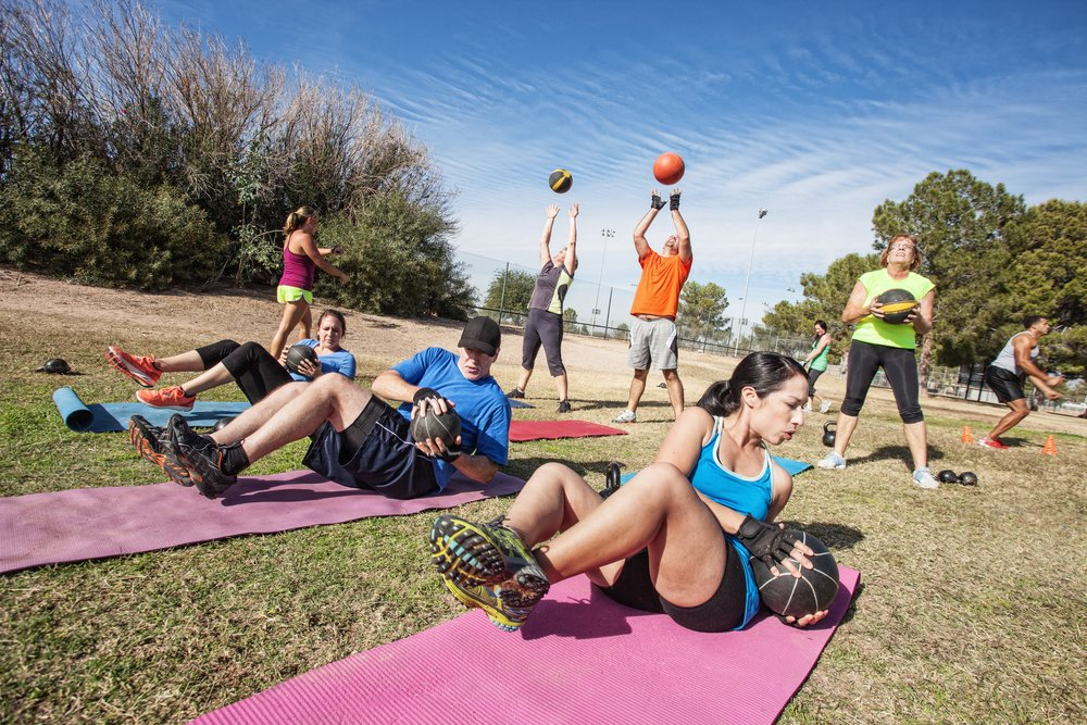 A group of adults doing bootcamps and outdoor fitness training