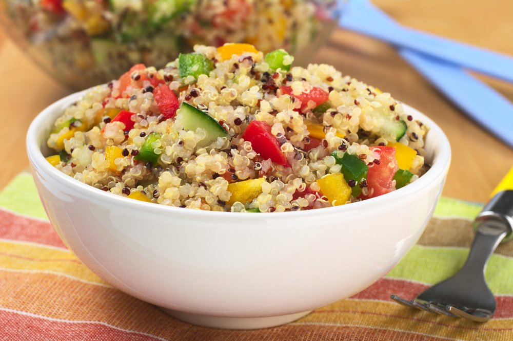 Delicious vegetarian quinoa salad with bell pepper, cucumber and tomatoes. Quinoa - superfood salad