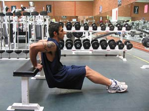 Working your triceps using bench dips