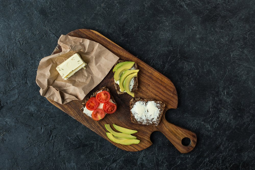 Healthy snacks on a wooden board. All part of making lifestyle changes stick