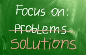 overcoming negative thoughts. Focus on solution written on a green board