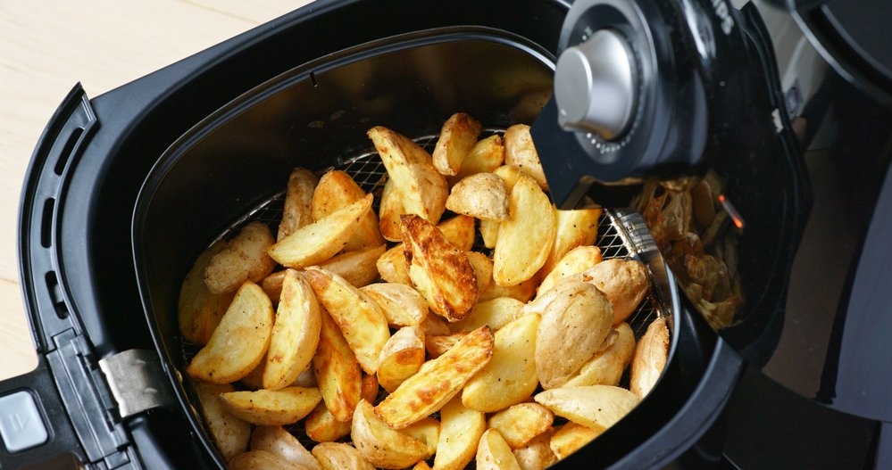 Air fryer homemade grilled potato. Air fryers are a healthy way to fry hot chips.