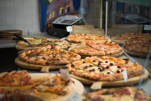 A selection of pizzas on a counter top. Diet and body composition are clearly linked.