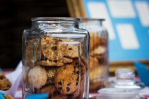 Cookies in jars on a shelf - a perfect example of a snack attack weakness