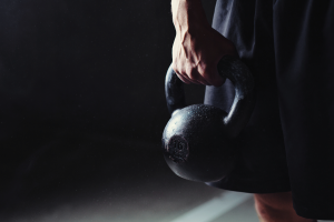 man holding kettle bell ready for CrossFit workout