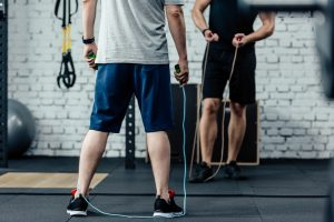 @ men in a gym with skipping ropes. Jumping rope is one of the best cardio exercises.