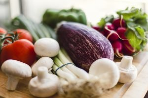 Fresh vegetables on a wooden chopping board. Food terms like 'organic' can be confusing