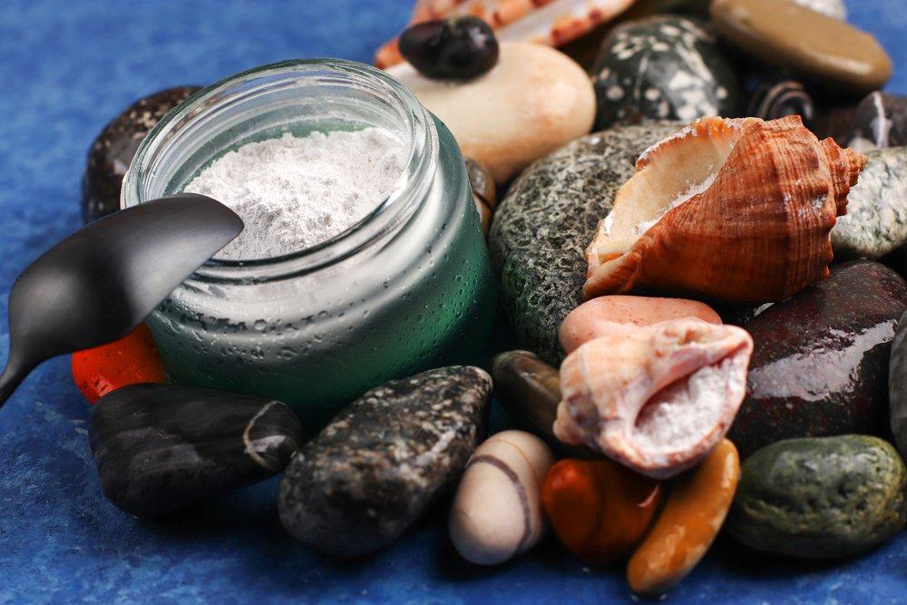 Collagen powder. Natural supplement. Marine collagen powder on the background of stones. Healthy lifestyle concept. Hydrolyzed collagen in a glass jar.